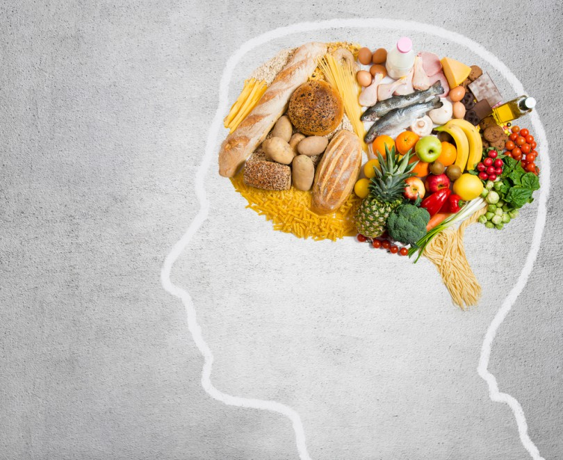 Ilustração de cabeça com alimentos dentro.