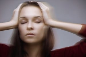 Suffering from headache - concept. Motion effect