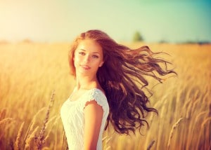 Beauty Girl Outdoors enjoying nature. Beautiful Teenage Model gi