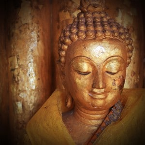 buddha statue sculpture with golden face in temple buddhism