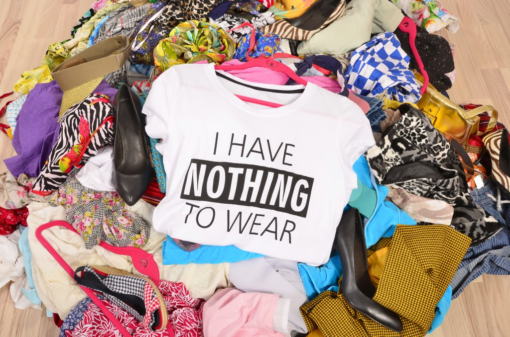 Big Pile Of Clothes Thrown On The Ground With A T-shirt Saying N