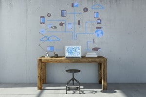 Laptop computer with cloud computing concept on the wall and the