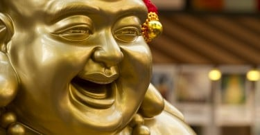 A close up shot of the chinese laughing buddha.