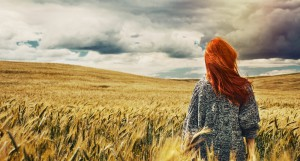 Young Traveller Standing Back On Plain Field And Breathtaking Vi