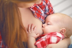 breastfeeding. mother breast feeding her baby toddler