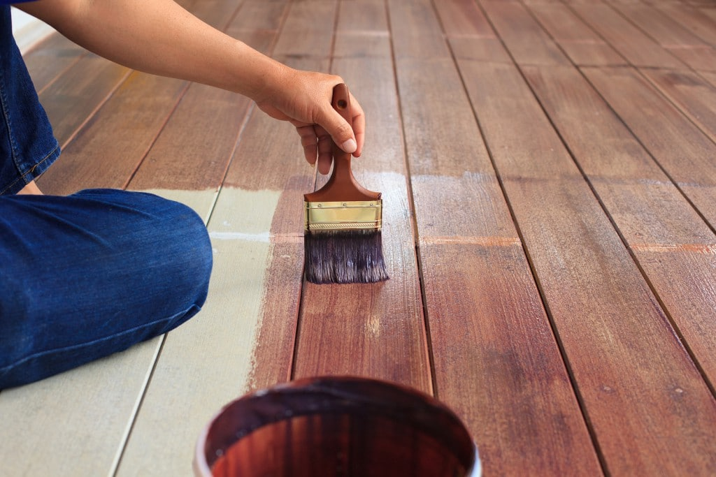hand painting oil color on wood floor use for home decorated house renovation and housing construction theme