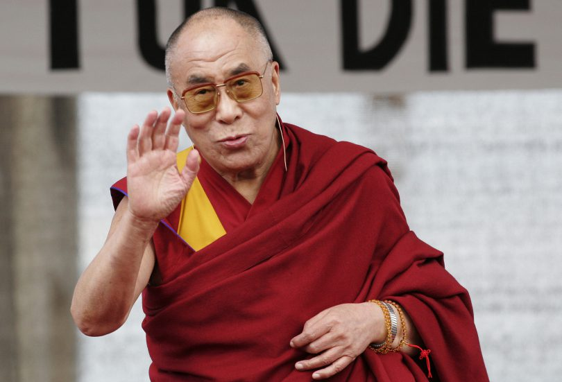 BERLIN - MAY 19 : The Dalai Lama speaks to his supporters at the Brandenburger Gate in Berlin on May 19 2008.
