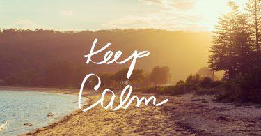 Handwritten text over sunset calm sunny beach background KEEP CALM vintage filter applied motivational concept image