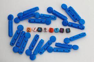 Diabetic lancets and alphabet plastic block with word diabetes. Diabetic concept.