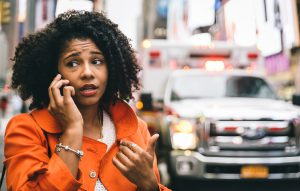 Afro American Woman Calling 911 In New York City. Concept About