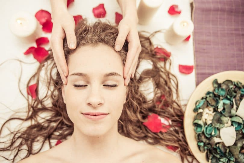 head massage. young woman making massage in the spa. concept about beauty spa and massages