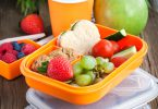 Lunch box for kids with sandwich cookies fresh veggies and fruits