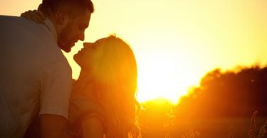 stunning sensual young couple in love posing in summer field at the sunset happy lifestyle concept ** Note: Soft Focus at 100%, best at smaller sizes
