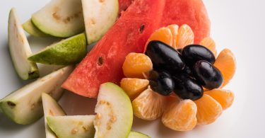 fruit salad or cut fruits, Diet, healthy fruit salad in the white bowl - healthy breakfast, weight loss concept, Fruit plate, Diet fruit salad in white plate, closeup