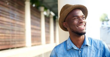 Close up portrait of a cheerful young african american man laughing