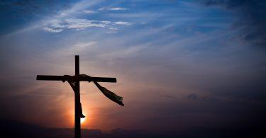 Dramatic Easter Sunrise Lighting and Christian Cross