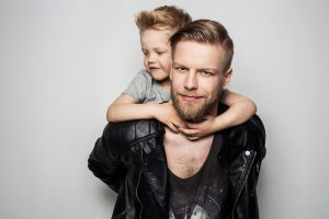 Happy Father and Son. Fathers day. Studio portrait over white background
