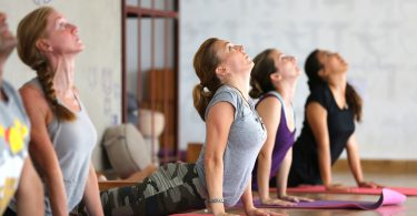 Kathmandu, Nepal - September 09, 2014: Yoga enthusiasts participate in yoga classes in Kathmandu.
