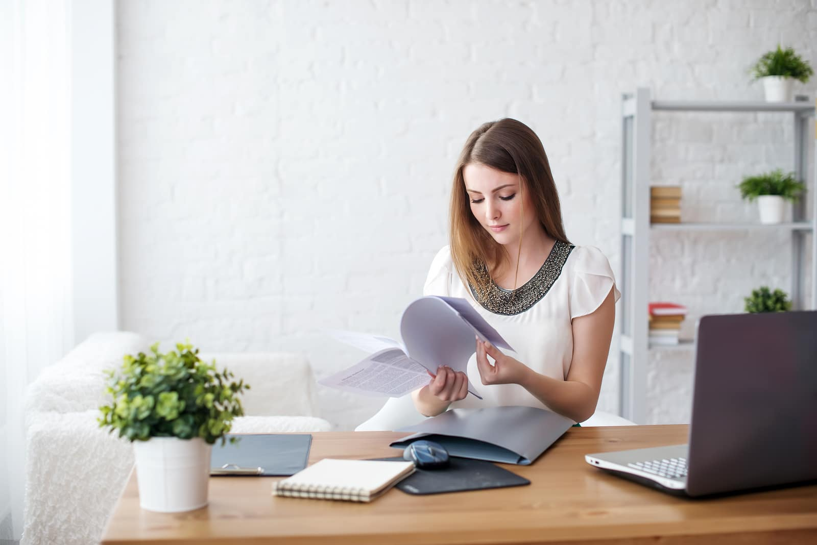 businesswoman with laptop and diary concept freelance work at ho