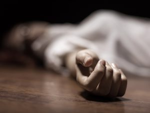 The dead woman's body. Focus on hand ** Note: Shallow depth of field