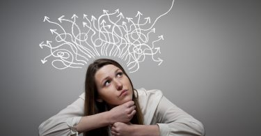 Thinking. Girl solving a problem. Conceptual image.