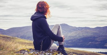 Woman is Relaxing On a Mountain Top