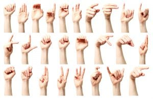 Sign language - a collage of the American sign language alphabet presented by a Caucasian young female hand.