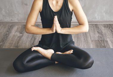 Woman practicing yoga in various poses (asana)