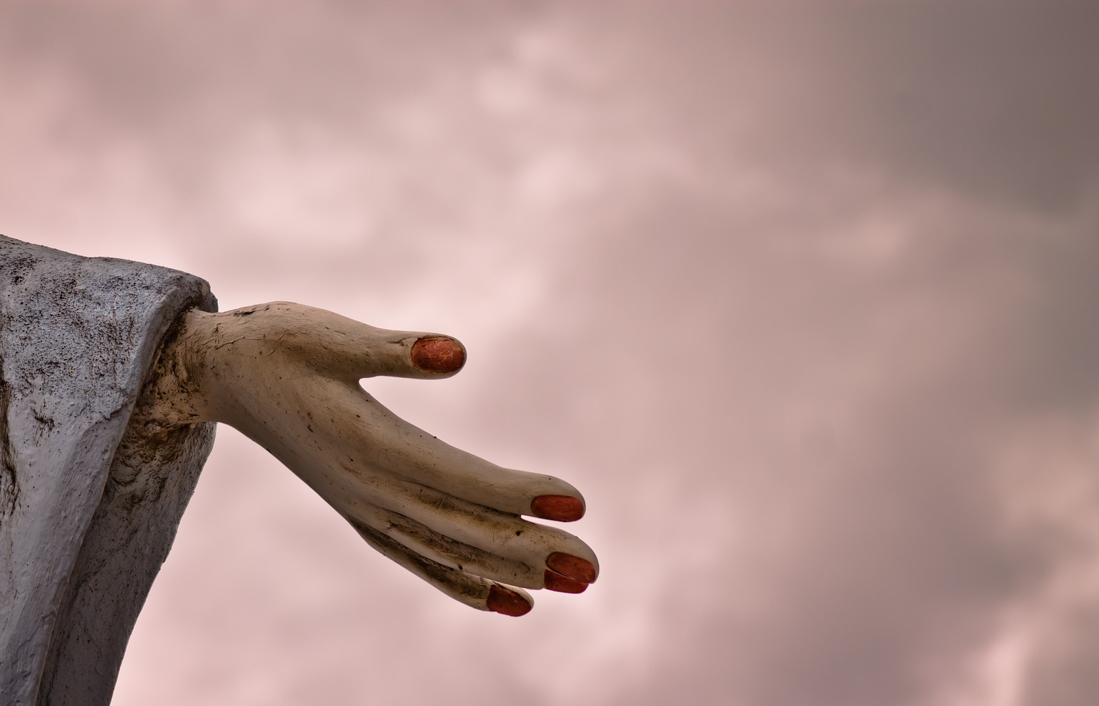 Hand of the statue of Iemanja shot againt cloudy sky