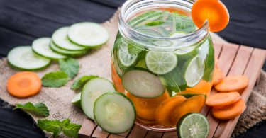 Summer fresh fruit Flavored infused water of cucumber carrot and lime