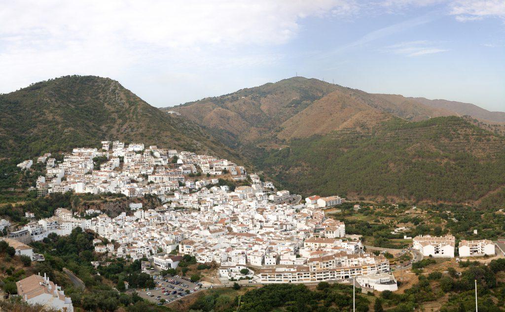 Aerial view of Ojen white village over a hillside near Marbella Spain. Panoramic