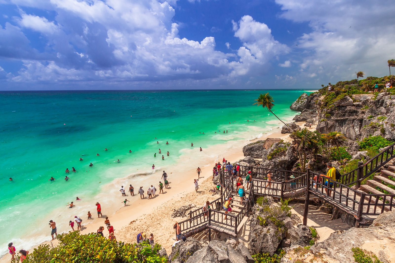 TULUM, MEXICO - JULY 15, 2011: Idyllic beach of Tulum with people swiming in caribbean sea, Quintana Roo, Mexico. Tulum is an archaeological site in the Riviera Maya, Yucatan.