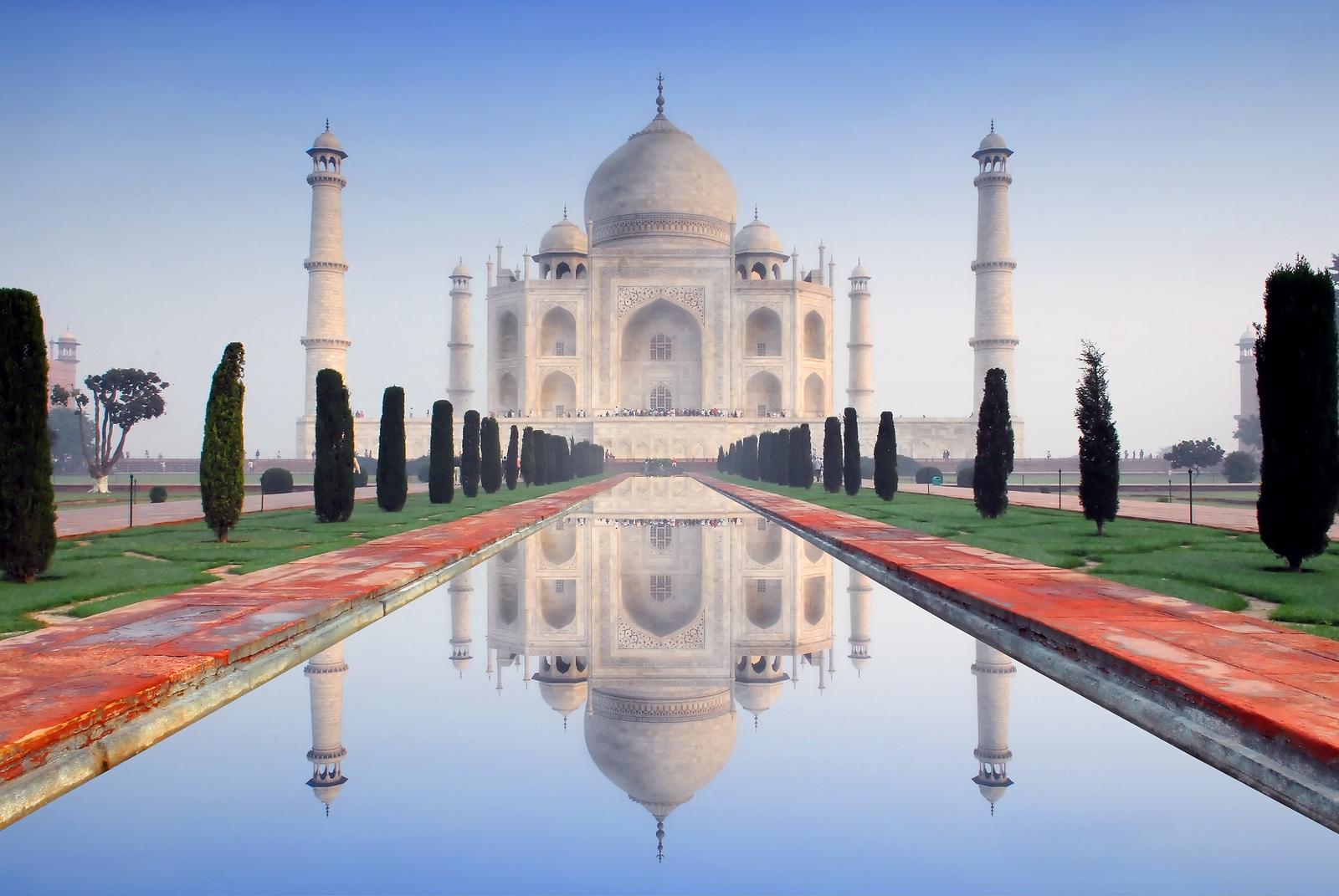 world wonder taj mahal in soft early morning light with blue sky