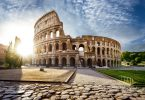 Colosseum in Rome and morning sun Italy