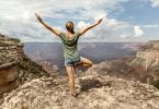 Freedom Girl with hands up on top of the Mountain at Grand Canyon National Park Arizona