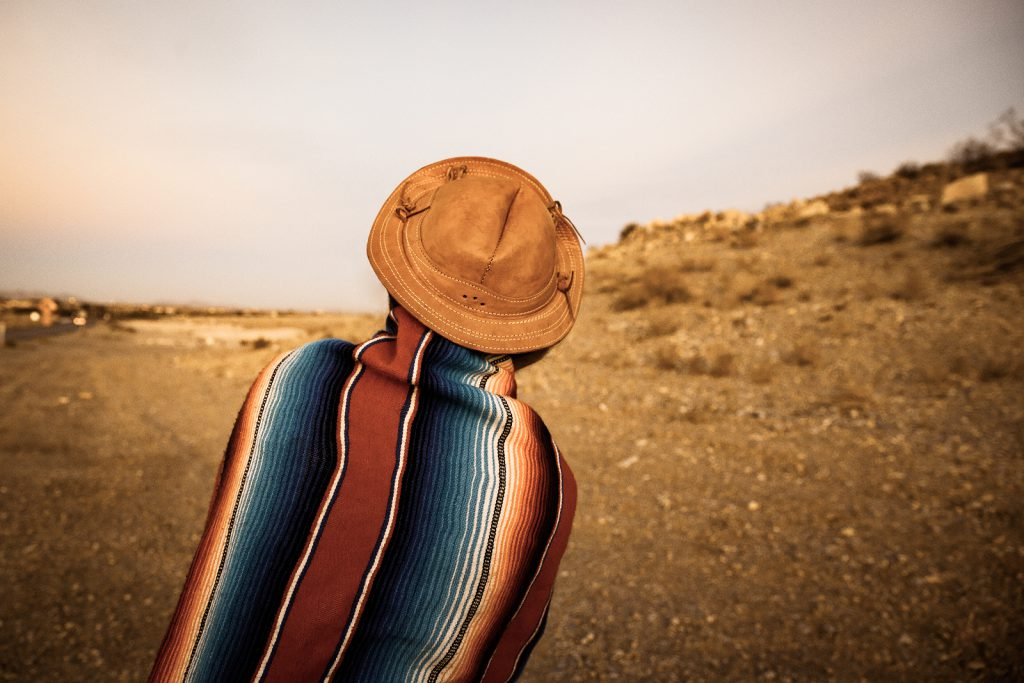 Hipster Traveler in desert of southern Nevada USA