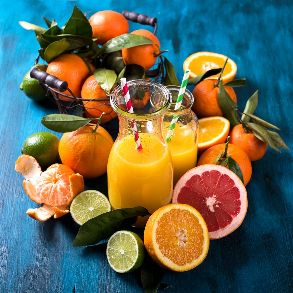 Citrus vitamin juice healthy drink with fresh fruits lime grapefruit orange tangerine. Refreshing homemade lemonade. Breakfast beverage. Square image