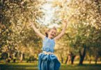 Happy child running and jumping in the park