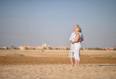 Happy Mature couple in love enjoy fresh air and stunning view on vacation