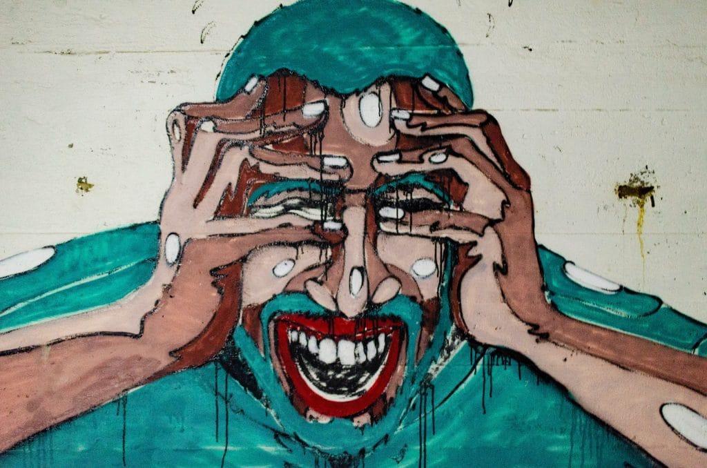 Ilustração de homem com as mãos na cabeça.