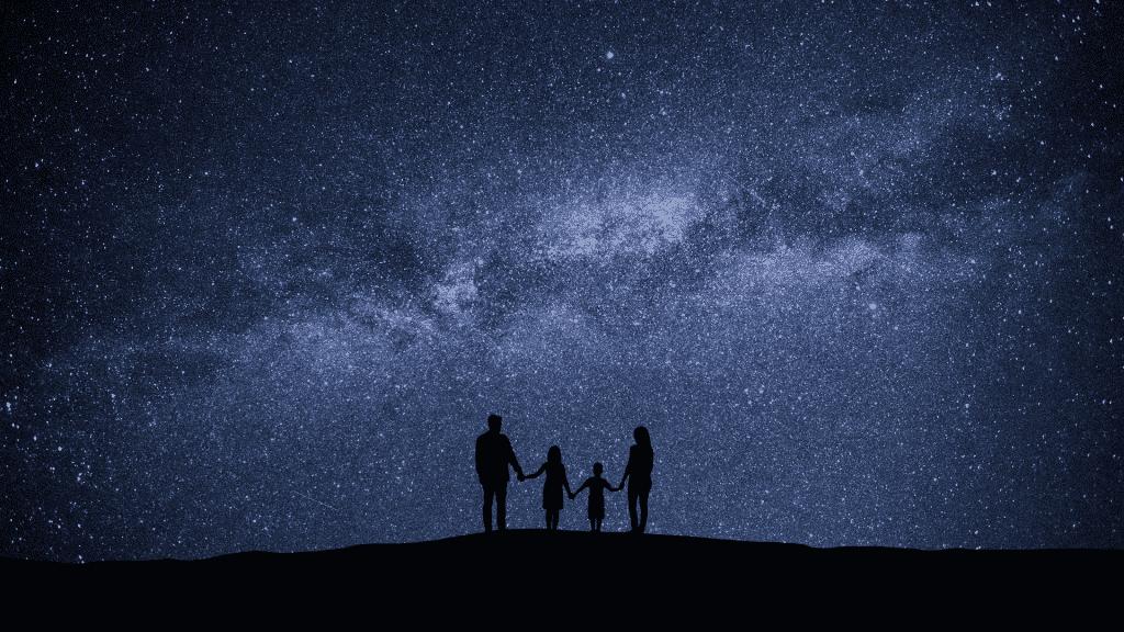 Família observando o céu noturno estrelado