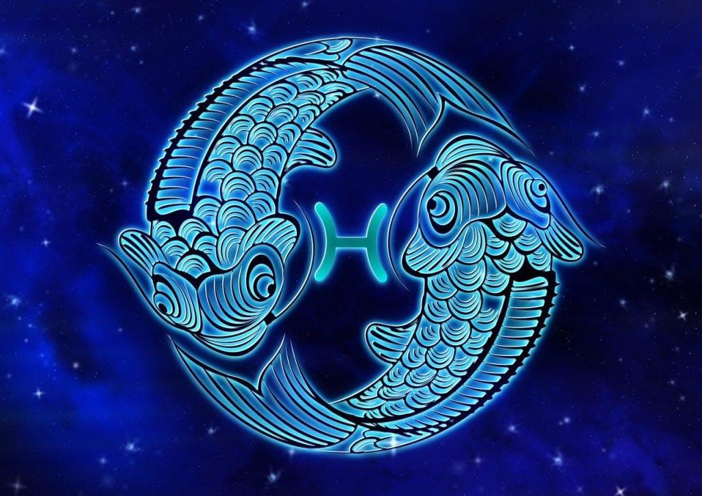 Representação do signo de Peixes com o fundo azul.