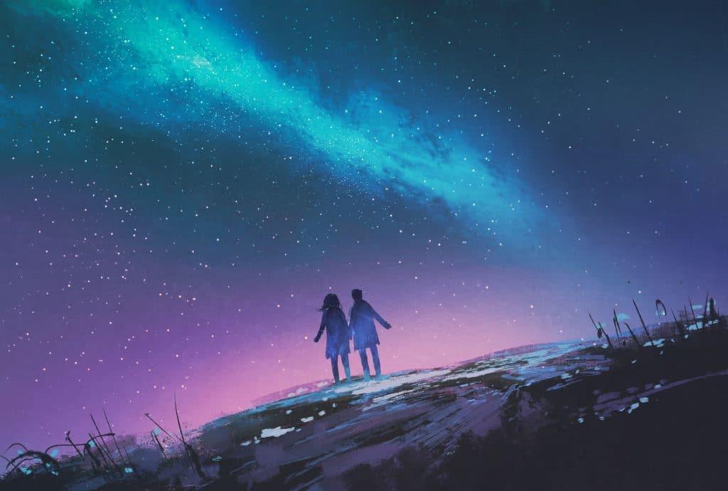 Silhueta de um casal de mãos dadas com uma galáxia de fundo.