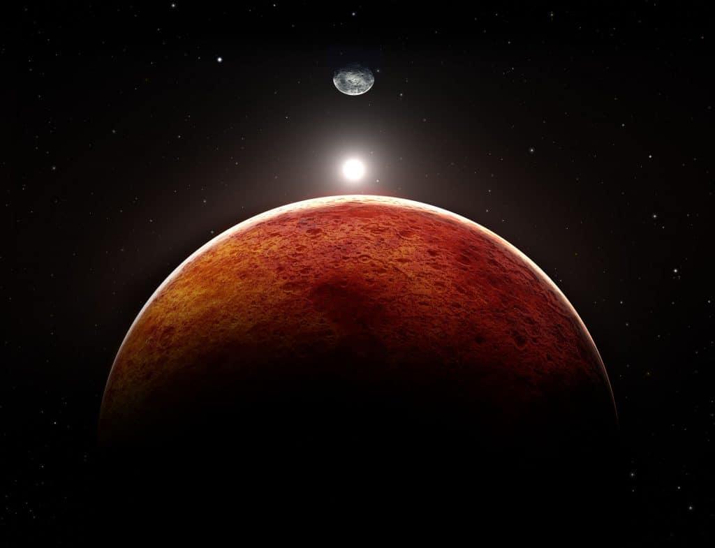 Planeta marte com a lua de fundo.