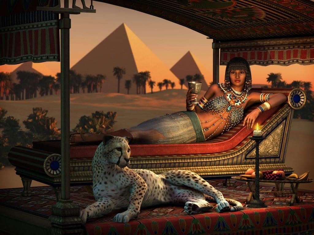 Desenho gráfico de uma Cleópatra deitada ao lado de uma cheetah tomando vinho.