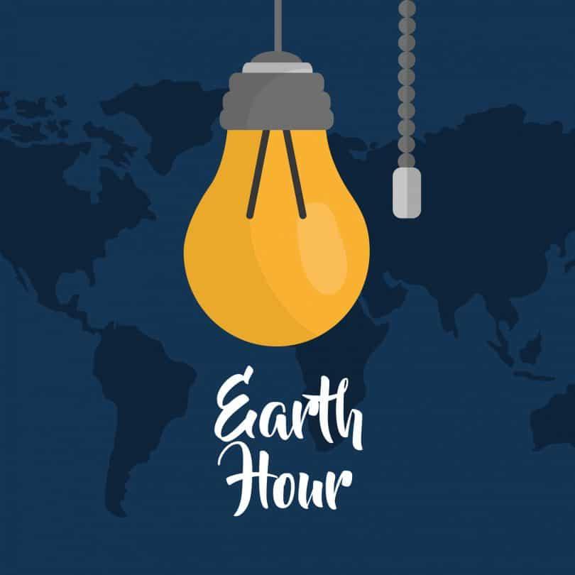 Ilustração de lampada amarela , com o as palavras hora da terra em inglês, de fundo há um mapa mundo todo azul marinho.
