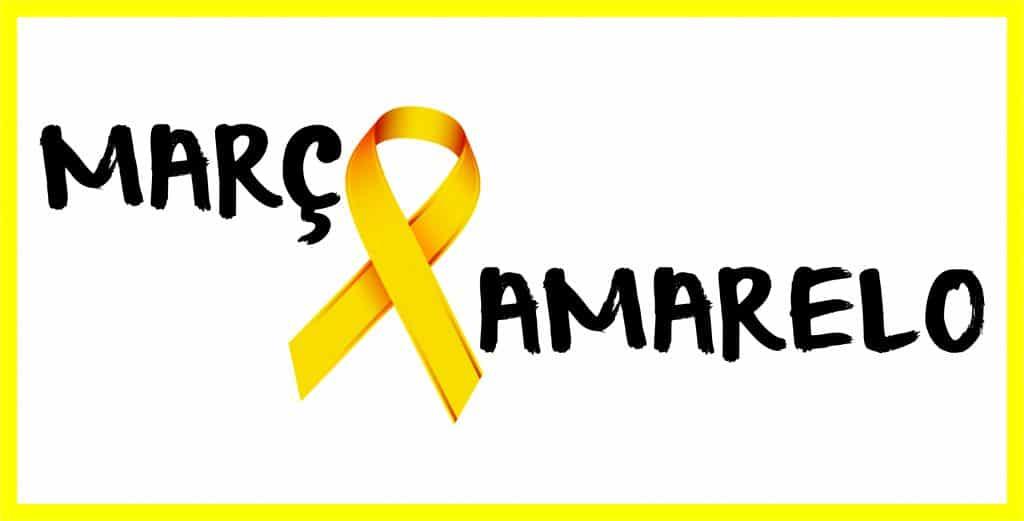 """Laço amarelo com frase """"Março Amarelo"""" ao lado."""
