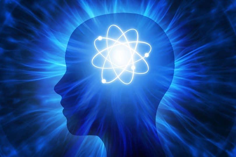 Ilustração de cabeça com átomo iluminado