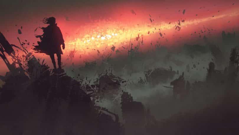 Silhueta de uma menina em cima de uma montanha observando o mundo destruído à sua frente.