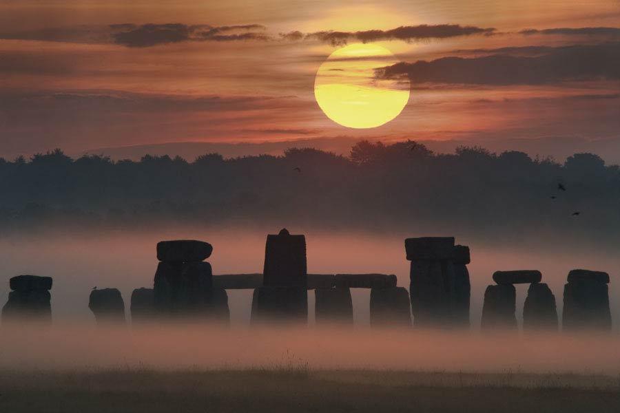Pôr-do-sol sobre Stonehenge.